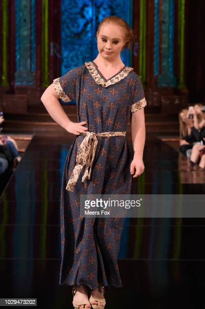 Model Madeline Stuart walks the runway during the RUTU BHONSLE show at New York Fashion Week Powered By Art Hearts Fashion at The Angel Orensanz...