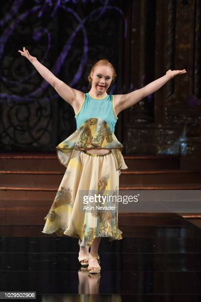 Model Madeline Stuart walks the runway during the TOPPING DESIGN show at New York Fashion Week Powered By Art Hearts Fashion at The Angel Orensanz...