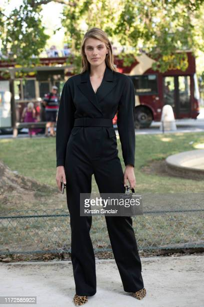 Model Madison Headrick wears a Mark Cross bag and a Prada jumpsuit on July 02 2019 in Paris France