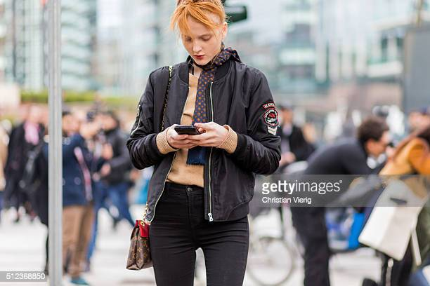 Model Madison Stubbington wearing a black bomber jacket and a Louis Vuitton bag seen outside Costume National during Milan Fashion Week Fall/Winter...