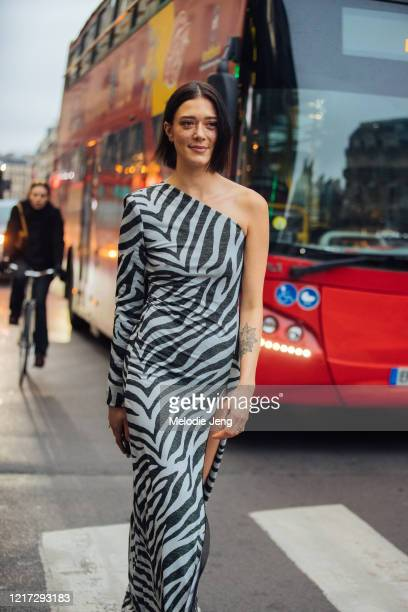 Model Maeva Marshall wears a single-shoulder zebra print dress after the Redemption show during Paris Fashion Week Fall/Winter 2020 on February 28,...