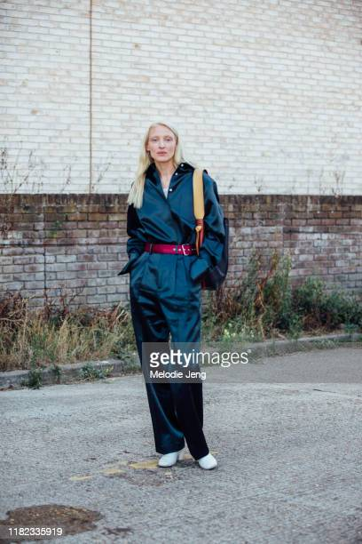 Model Maggie Maurer wears a blue satin Peter Do jumpsuit after the Preen by Thornten Bregazzi show during London Fashion Week September 2019 on...
