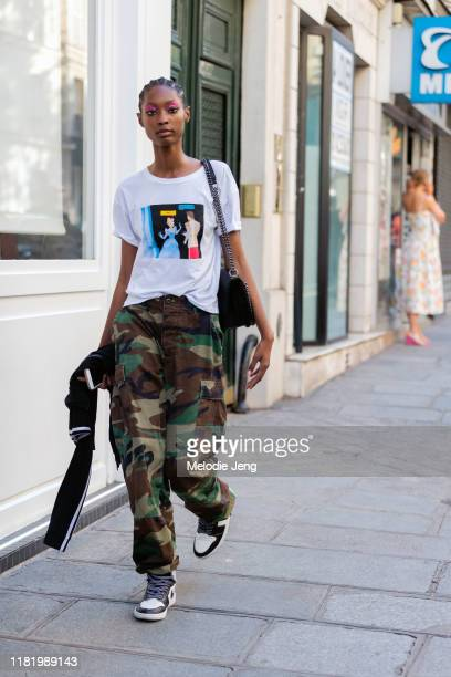 Model Makala Johnson wears a white meme t-shirt, green camouflage pants, and Nike Air Jordan sneakers after the Valentino show during Couture Fashion...