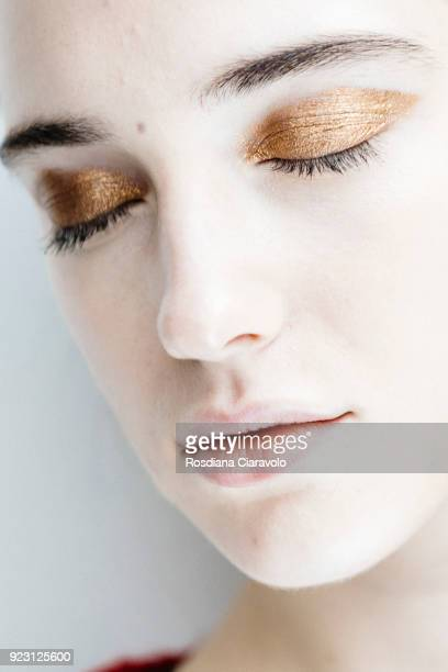 Model make up detail is seen backstage ahead of the Arthur Arbesser show during Milan Fashion Week Fall/Winter 2018/19 on February 21 2018 in Milan...