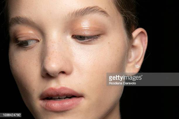 Model make up detail is seen backstage ahead of the Fila show during Milan Fashion Week Spring/Summer 2019 on September 23 2018 in Milan Italy