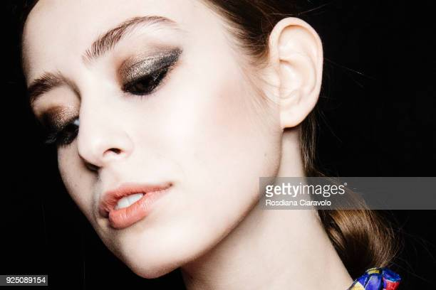 Model, make up detail, is seen backstage ahead of the Piccione.Piccione show during Milan Fashion Week Fall/Winter 2018/19 on February 25, 2018 in...