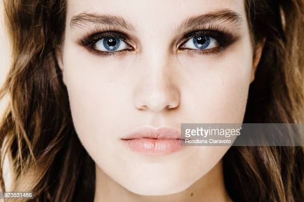 Model make up detail Luna Bijl is seen backstage ahead of the Etro show during Milan Fashion Week Fall/Winter 2018/19 on February 23 2018 in Milan...