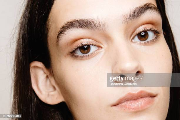 Model, make up detail, poses backstage at the Simona Marziali - MRZ fashion show during the Milan Women's Fashion Week on September 23, 2020 in...