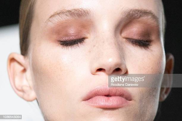 Model make up detail Rebecca Longendyke is seen backstage ahead of the Max Mara show during Milan Fashion Week Spring/Summer 2019 on September 20...