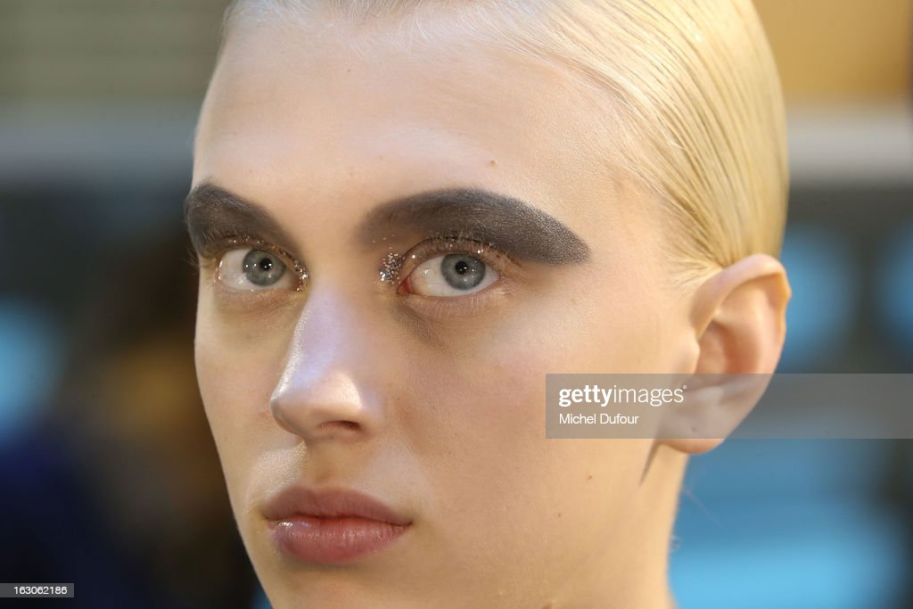 A model make up in backstage at the John Galliano Fall/Winter 2013 Ready-to-Wear show as part of Paris Fashion Week at Le Centorial on March 3, 2013 in Paris, France.