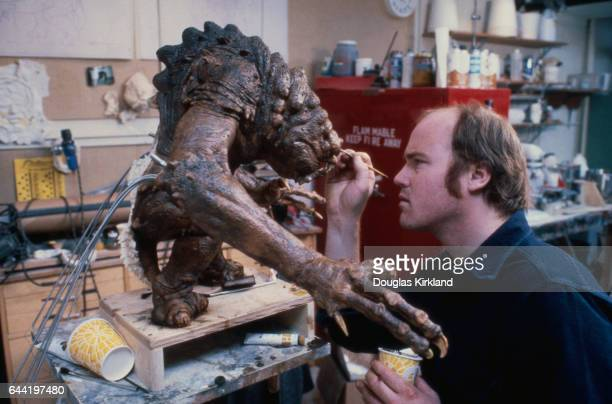 A model maker for Industrial Light and Magic puts the finishing touches on the Rancor one of the fierce creatures Luke Skywalker must battle in the...