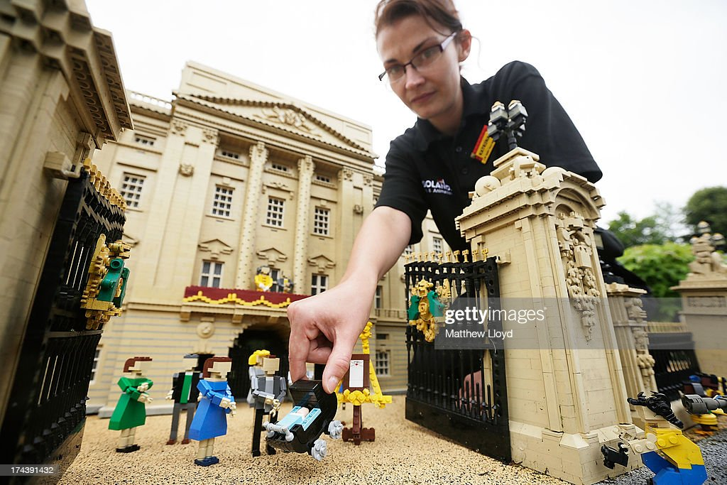 Model maker Katrina James places a Lego model of HRH Prince George of Cambridge outside a model of Buckingham Palace, part of a new attraction created to commemorate the birth of HRH Prince George of Cambridge at the Legoland resort on July 25, 2013 in Windsor, England. Model maker Katrina James constructed the baby and pram model out of 55 bricks, with the palace made out of 36,000 bricks. Catherine, Duchess of Cambridge gave birth to HRH Prince George of Cambridge at 16.24 BST on Monday July 22, 2013 with Prince William, Duke of Cambridge at her side.