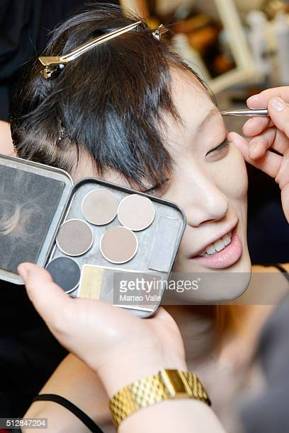 A model makeup detail is seen backstage ahead of the Salvatore Ferragamo show during Milan Fashion Week Fall/Winter 2016/17 on February 28 2016 in...