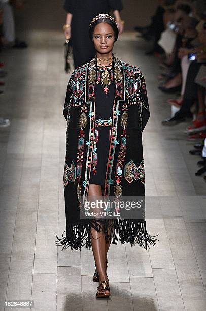 Model Malaika Firth walks the runway during Valentino show as part of the Paris Fashion Week Womenswear Spring/Summer 2014 at Espace Ephemere...