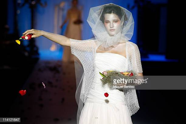 Model Malena Costa walks the runway at a presentation of the new bridal collection by Raimon Bundo during Barcelona Bridal Week on May 12 2011 in...
