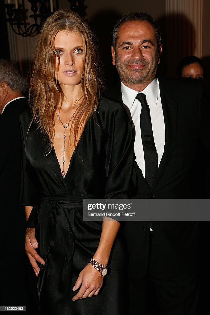 Model Malgosia Bela and Jean-Yves Le Fur attend the Bulgari and Vogue Party at Apicius Restaurant as part of the Paris Fashion Week Womenswear Spring/Summer 2014 on September 28, 2013 in Paris, France.