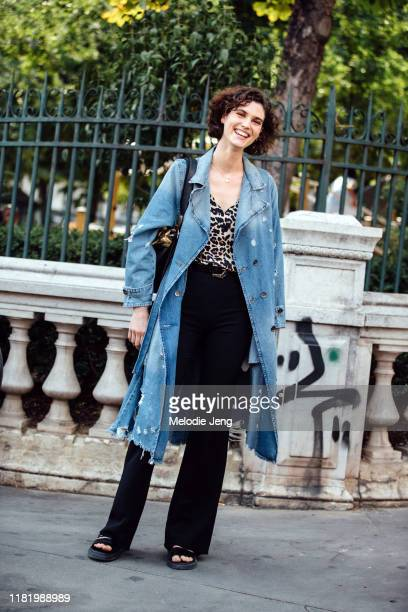 Model Manon Leloup wears a denim trench, leopard top, black pants after the Jean Paul Gaultier show during Couture Fashion Week Fall/Winter 2019 on...