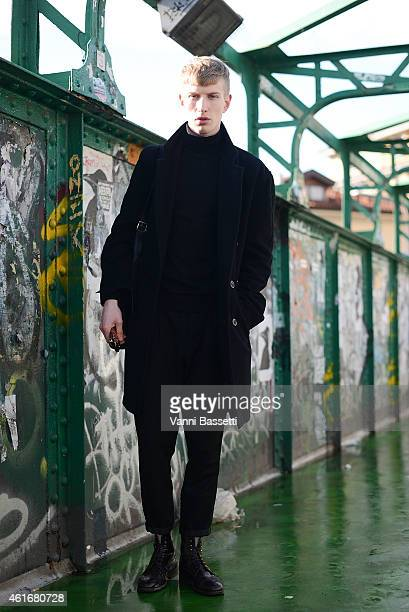 Model Marc Finch poses wearing a vintage coat Lanvin top and Poste shoes on January 17 2015 in Milan Italy