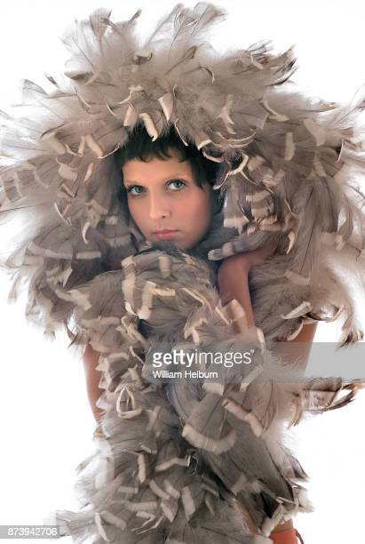 Model Maria Badeaux wrapped in an enormous feather boa 1971
