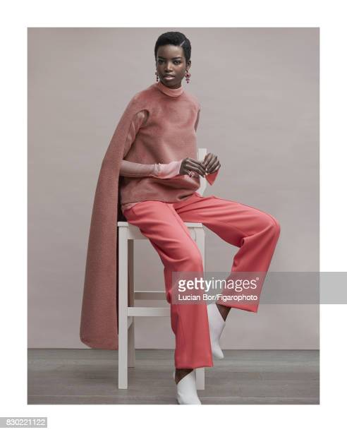 Model Maria Borges poses at a fashion shoot for Madame Figaro on July 8 2017 in Paris France Cape blouse pants and shoes earrings and ring Makeup by...