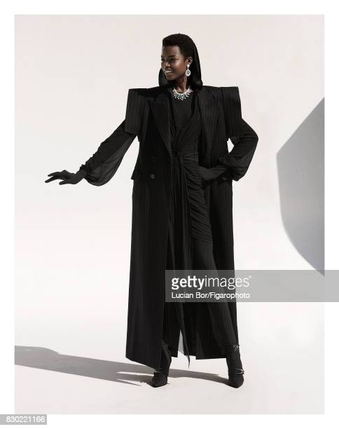 Model Maria Borges poses at a fashion shoot for Madame Figaro on July 8 2017 in Paris France Coat dress outfit and shoes earrings and necklace Makeup...