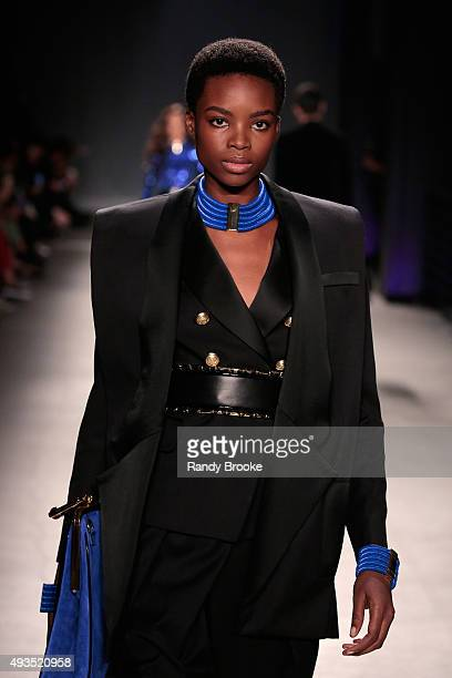 Model Maria Borges walks the runway at the BALMAIN X HM Collection Launch at 23 Wall Street on October 20 2015 in New York City