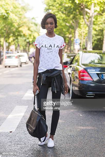 Model Maria Borges wears an Alaia tshirt and carries a Givenchy purse after Ulyana Sergeenko on Day 3 of Paris Haute Couture Fashion Week...