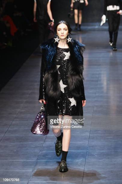 Model Maria Carla Boscono walks the runway during the Dolce & Gabbana show as part of Milan Fashion Week Womenswear Autumn/Winter 2011 on February...
