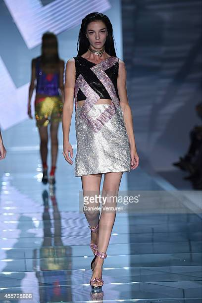 Model Maria Carla Boscono walks the runway during the Versace show as a part of Milan Fashion Week Womenswear Spring/Summer 2015 on September 19,...