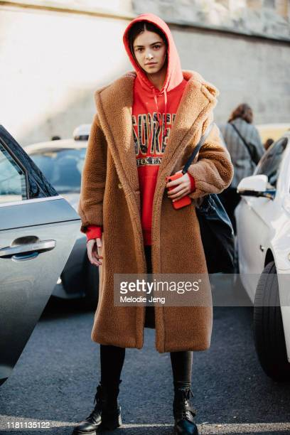 Model Maria Miguel wears a brown teddy bear coat red Supreme hoodie after the Lanvin show during Paris Fashion Week Fall/Winter 2019 on February 27...