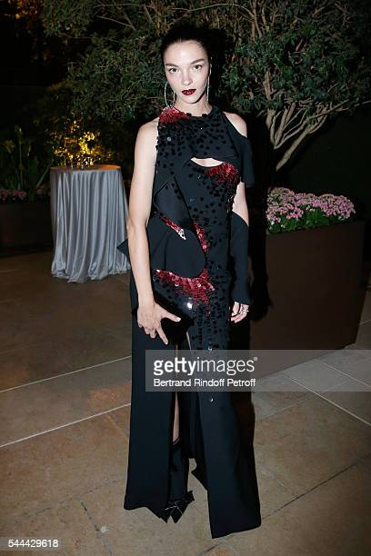 Model Mariacarla Boscono attends the Amfar Paris Dinner - Stars gather for Amfar during the Haute Couture Week - Held at The Peninsula Hotel on July...