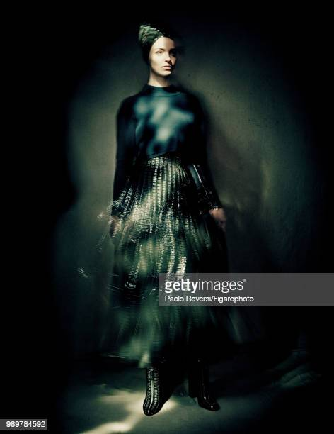 Model Mariacarla Boscono poses at a fashion shoot for Madame Figaro on October 13, 2017 in Paris, France. Clothing and boots by Azzedine Alaia...