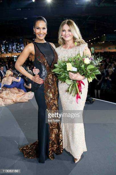 Model Marie Amiere and German presenter Frauke Ludowig attend the presentation of the collection VIGOUR vogue by designer Brian Rennie at arena...