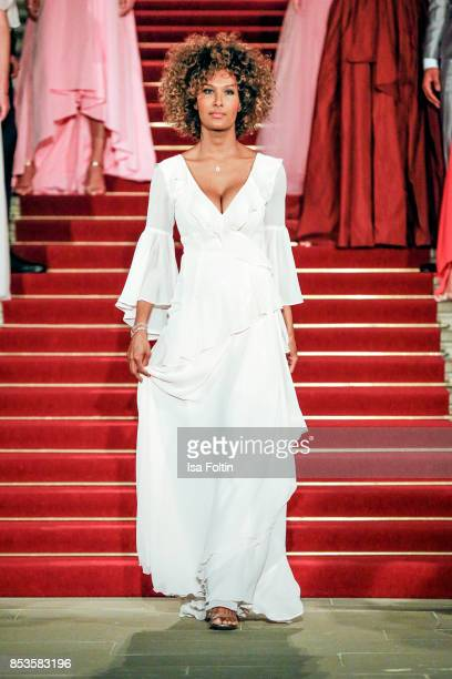 Model Marie Amière walks the runway during the Minx Fashion Night in favour of 'Sauti Kuu' of Auma Obama at Wuerzburger Residenz on September 23 2017...