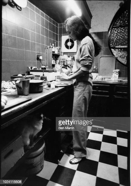 Model Marie Helvin preparing lunch in the kitchen of the London home she shares with photographer David Bailey UK August 8 1977