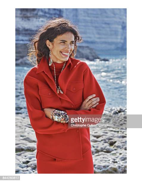 Model Marie Meyer poses at a fashion shoot for Madame Figaro on June 20 2017 in Etretat France Jacket sweater and skirt earring necklace and...