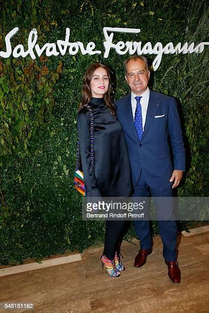 Model MarieAnge Casta and Leonardo Ferragamo attend the Re Opening of Salvatore Ferragamo Boutique at Avenue Montaigne on July 5 2016 in Paris France