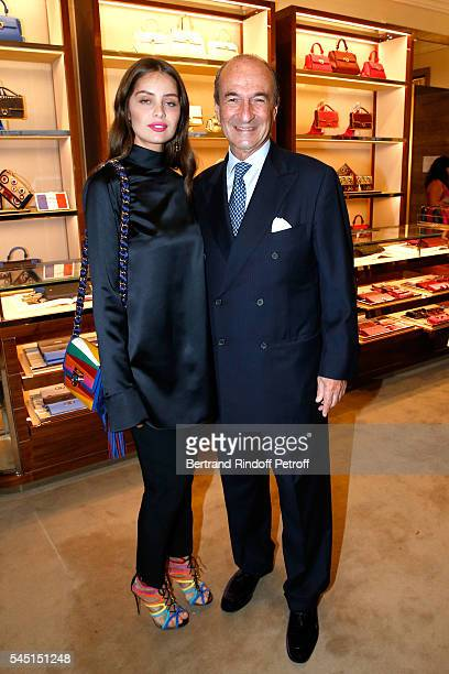 Model MarieAnge Casta and Michele Norsa attend the Re Opening of Salvatore Ferragamo Boutique at Avenue Montaigne on July 5 2016 in Paris France