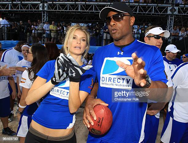 Model Marisa Miller and former NFL player Warren Moon attend the Fourth Annual DIRECTV Celebrity Beach Bowl at DIRECTV Celebrity Beach Bowl Stadium...