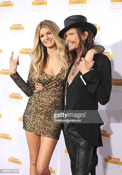 Model Marisa Miller and musician Steven Tyler of Aerosmith attends NBC and Time Inc celebrate the 50th anniversary of the Sports Illustrated Swimsuit...