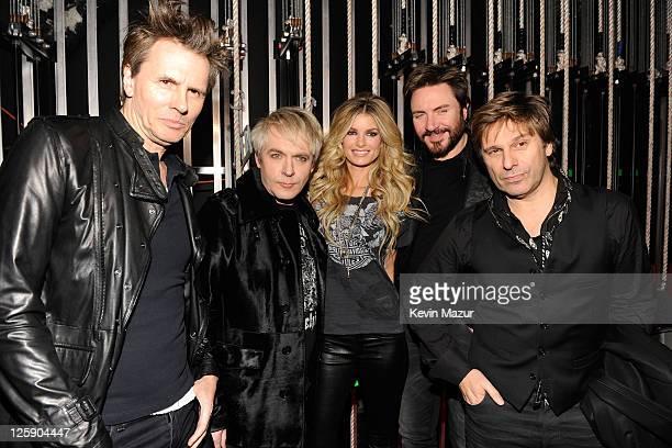 Model Marisa Miller poses backsatge with Duran Duran during VH1's Pepsi Super Bowl Fan Jam at Verizon Theater on February 3 2011 in Grand Prairie...