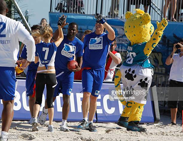 Model Marisa Miller singer Brian McKnight and actor Brandon Molale celebrate at the Fourth Annual DIRECTV Celebrity Beach Bowl at DIRECTV Celebrity...