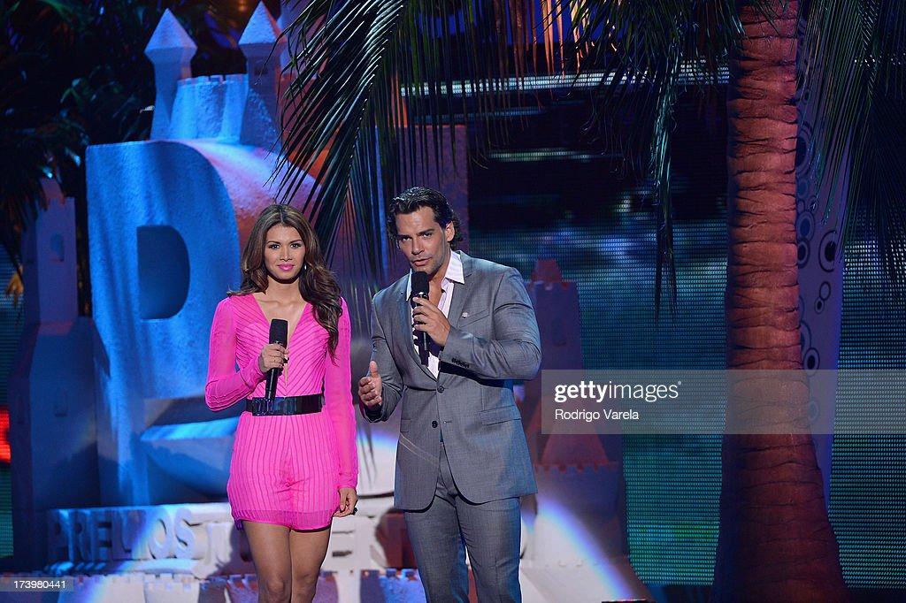 Model Marisela de Montecristo and Cristian de la Fuente speak onstage during the Premios Juventud 2013 at Bank United Center on July 18, 2013 in Miami, Florida.