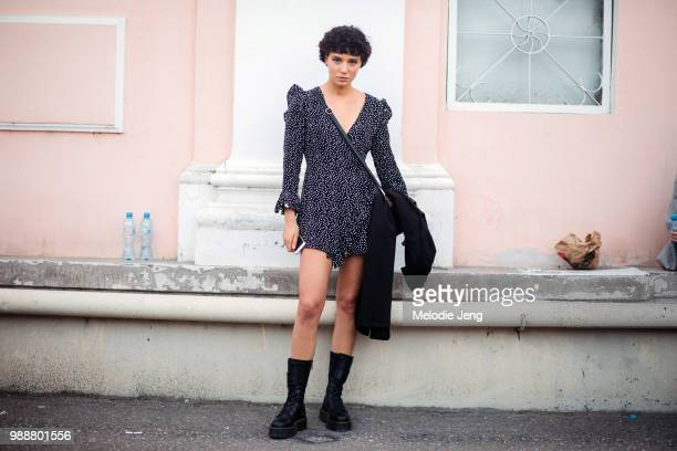Model Marita Gogodze wears a black and white polka-dot dress and chunky black boots during Mercedes-Benz Fashion Week Tbilisi Fall/Winter 2018 on May...