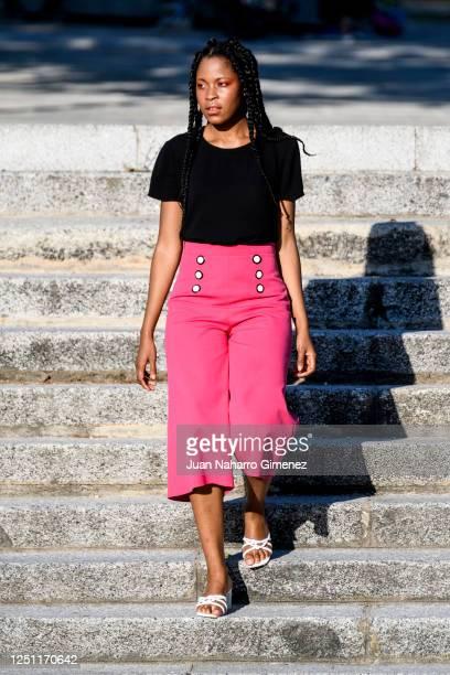Model Marizol Gonzalez wears Hugo Boss shirt, Dresses2Kill trousers and MANGO shoes on June 20, 2020 in Madrid, Spain.