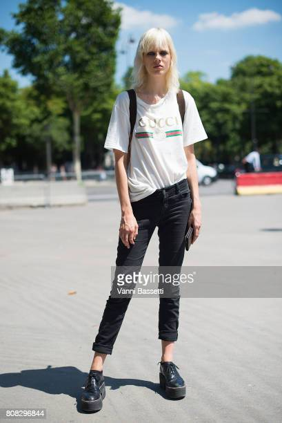 Model Marjan Jonkman poses wearing a Gucci t-shirt after the Chanel show at the Grand Palais during Paris Fashion Week Haute Couture FW 17/18 on July...