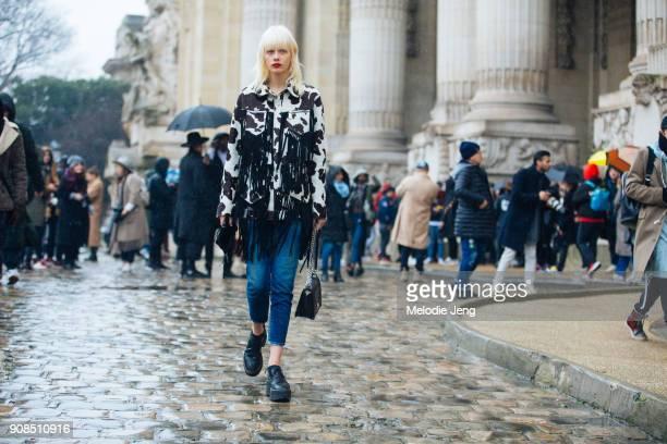 Model Marjan Jonkman wears a suede fringe cowprint jacket on January 21 2018 in Paris France