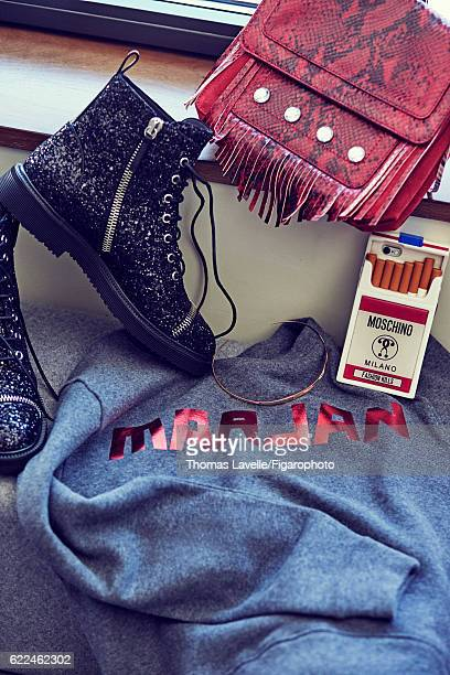 Model Marjan Jonkman's style inspirations are photographed for Madame Figaro on July 7, 2016 in Paris, France. Sweatshirt , choker , boots , iPhone...