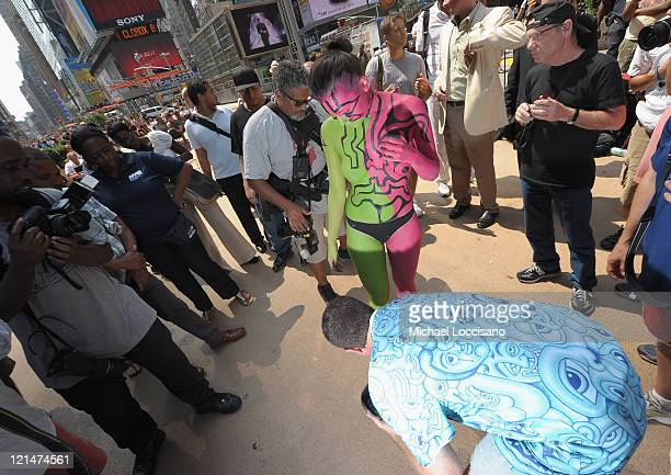Model Marla Mera is body painted in the nude by Andy Golub in Times Square on August 19 2011 in New York City