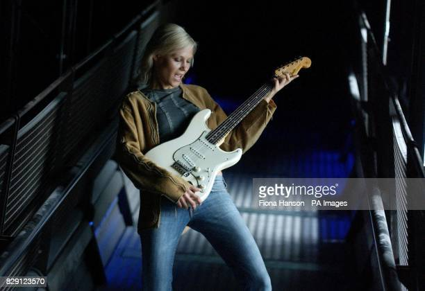 Model MarLiis Ival with a vintage lefthanded Stratocaster electric guitar valued at 10000 and an American made Cherokee style suede jacket valued at...